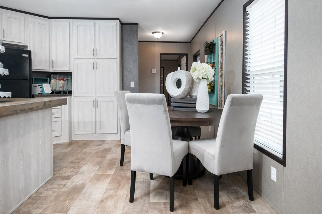 The MAXIMIZER 16763A Dining Area. This Manufactured Mobile Home features 3 bedrooms and 2 baths.