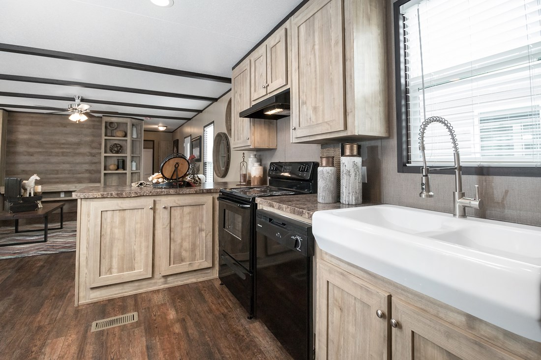 The MAXIMIZER 16763A Kitchen. This Manufactured Mobile Home features 3 bedrooms and 2 baths.