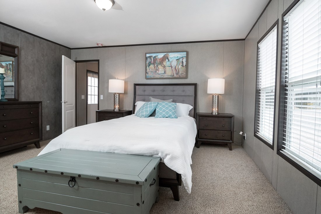 The MAXIMIZER 16763A Master Bedroom. This Manufactured Mobile Home features 3 bedrooms and 2 baths.