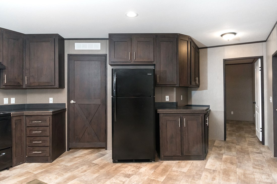 The SMART BUY 16763D Kitchen. This Manufactured Mobile Home features 3 bedrooms and 2 baths.