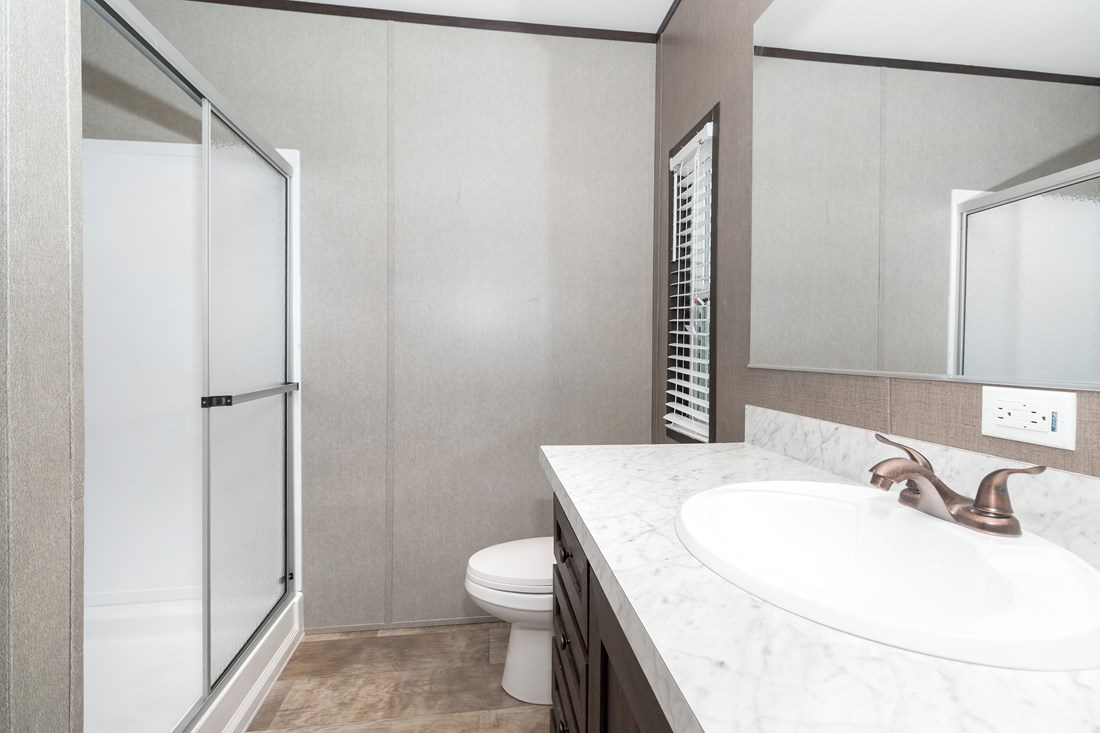The SMART BUY 16763D Master Bathroom. This Manufactured Mobile Home features 3 bedrooms and 2 baths.