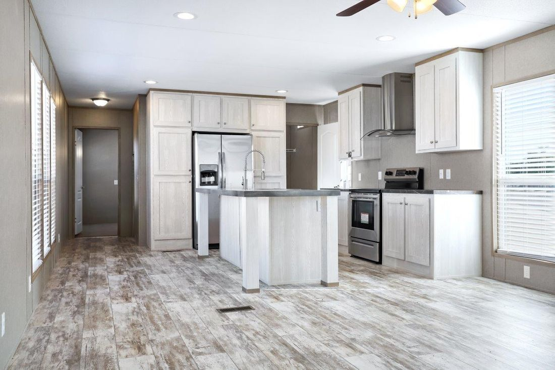 The RESOLUTION 16763X Kitchen. This Manufactured Mobile Home features 3 bedrooms and 2 baths.