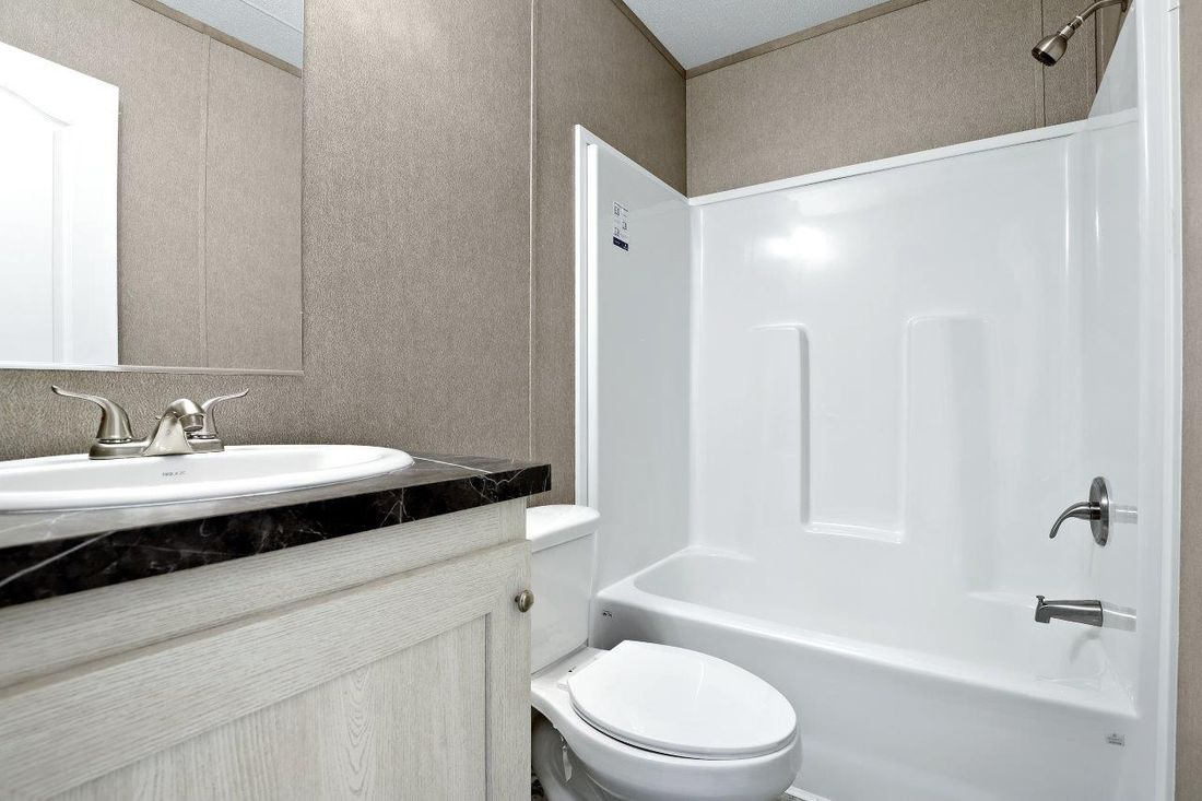 The RESOLUTION 16763X Guest Bathroom. This Manufactured Mobile Home features 3 bedrooms and 2 baths.