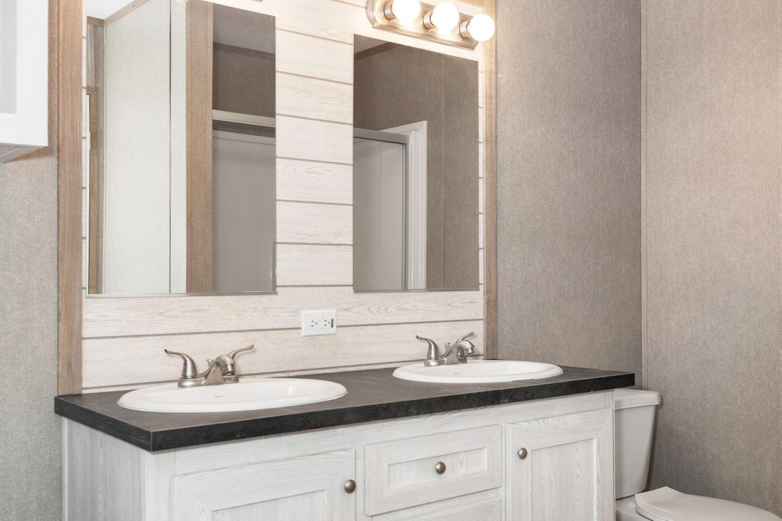 The RESOLUTION 16763X Master Bathroom. This Manufactured Mobile Home features 3 bedrooms and 2 baths.