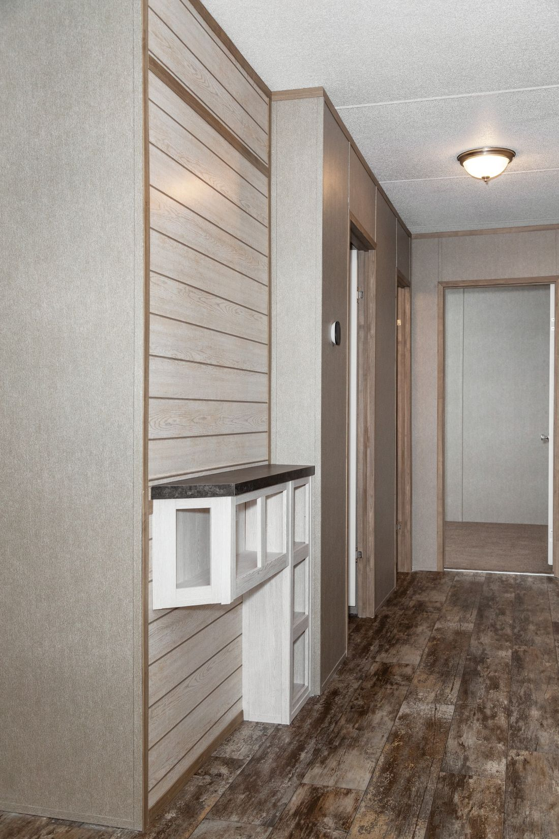 The RESOLUTION 16763X Foyer. This Manufactured Mobile Home features 3 bedrooms and 2 baths.