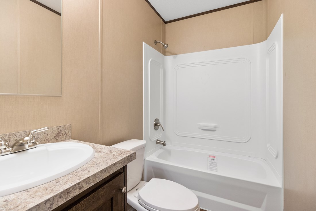 The SMART BUY 16763H Guest Bathroom. This Manufactured Mobile Home features 3 bedrooms and 2 baths.