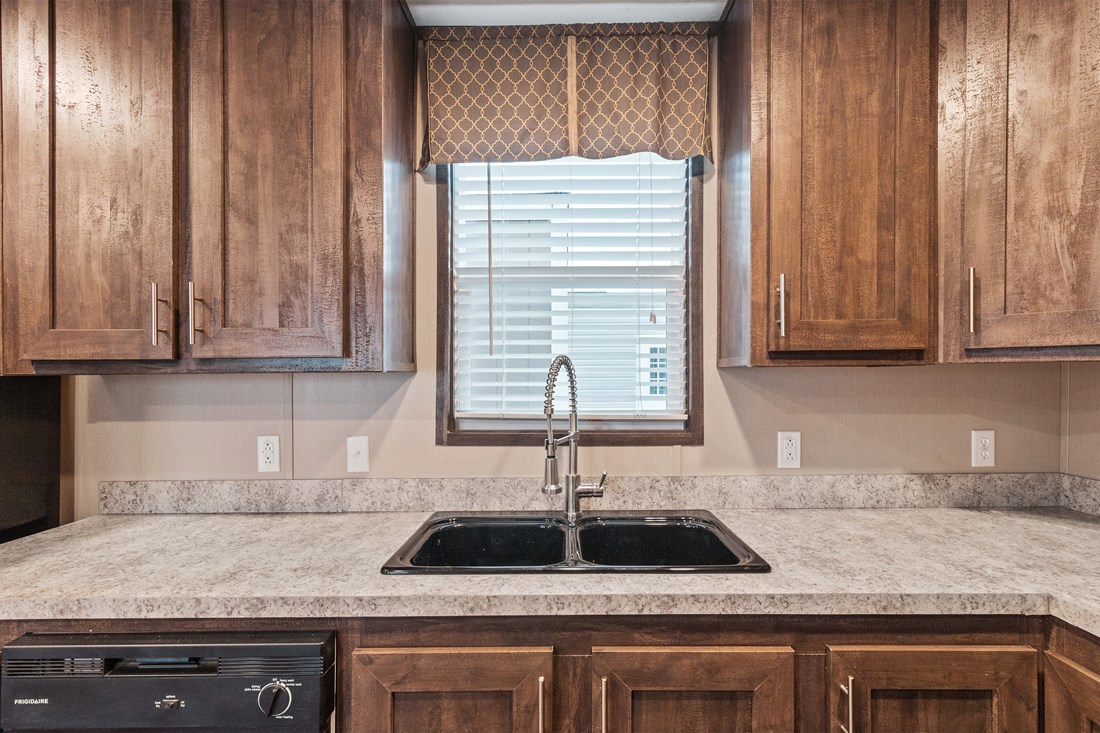 The SMART BUY 16763H Kitchen. This Manufactured Mobile Home features 3 bedrooms and 2 baths.