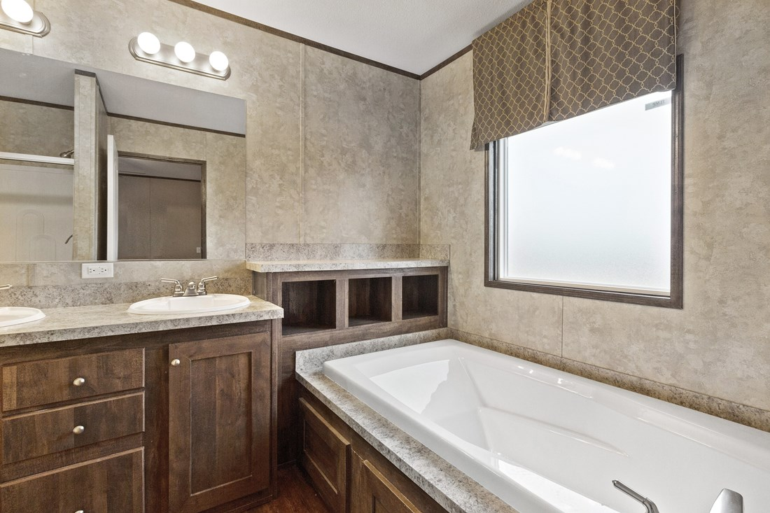 The SMART BUY 16763H Master Bathroom. This Manufactured Mobile Home features 3 bedrooms and 2 baths.