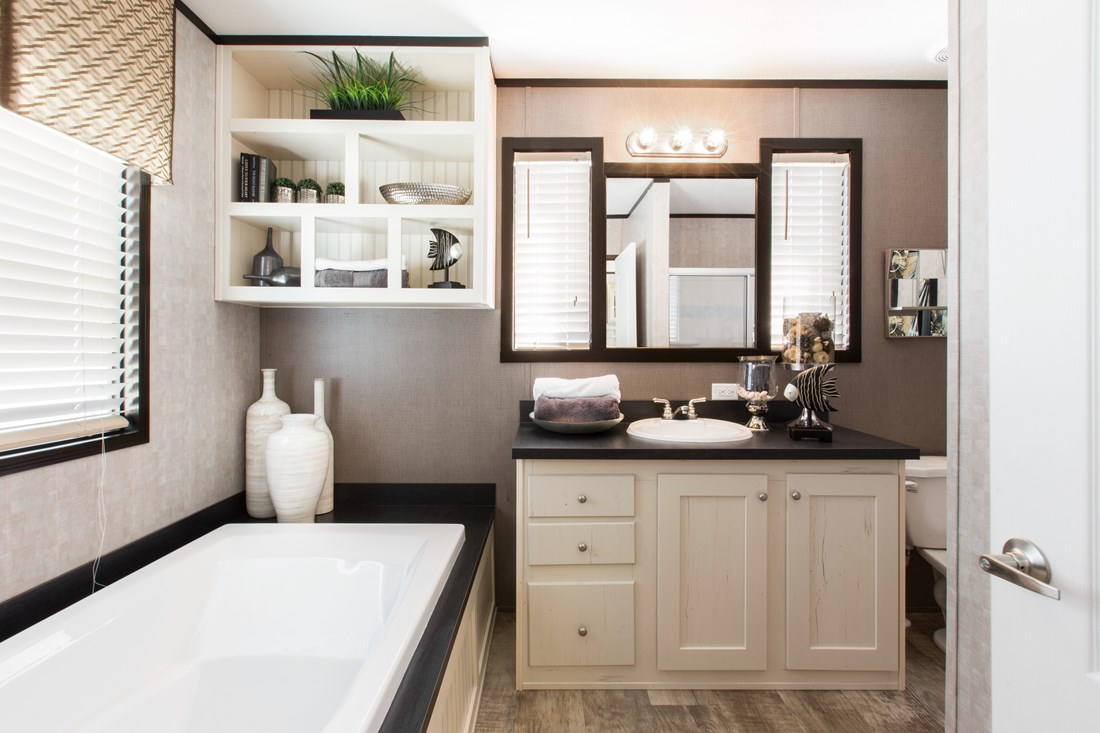 The SMART BUY 16803U Master Bathroom. This Manufactured Mobile Home features 3 bedrooms and 2 baths.