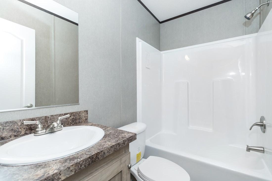 The SMART BUY 16763S Guest Bathroom. This Manufactured Mobile Home features 3 bedrooms and 2 baths.