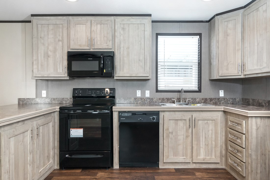 The SMART BUY 16763S Kitchen. This Manufactured Mobile Home features 3 bedrooms and 2 baths.