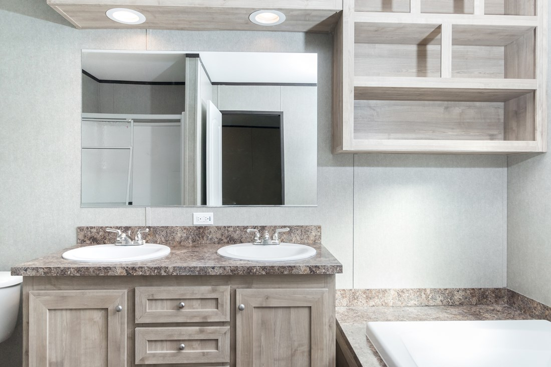 The SMART BUY 16763S Master Bathroom. This Manufactured Mobile Home features 3 bedrooms and 2 baths.