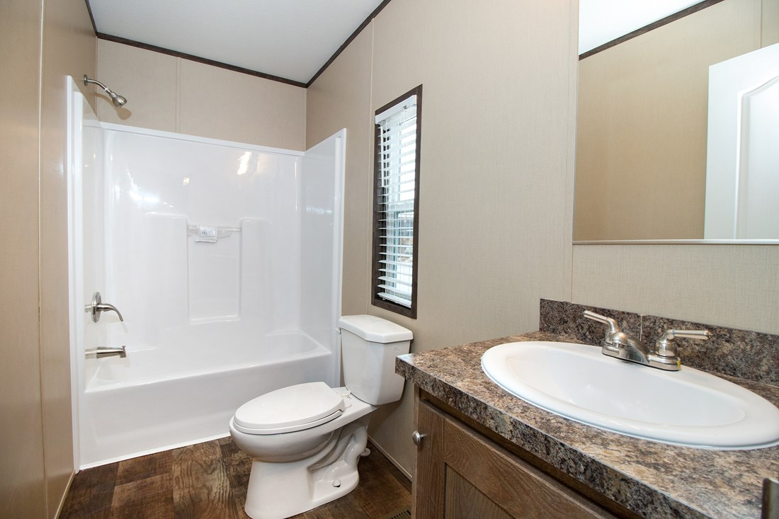 The SMART BUY 16764F Guest Bathroom. This Manufactured Mobile Home features 4 bedrooms and 2 baths.