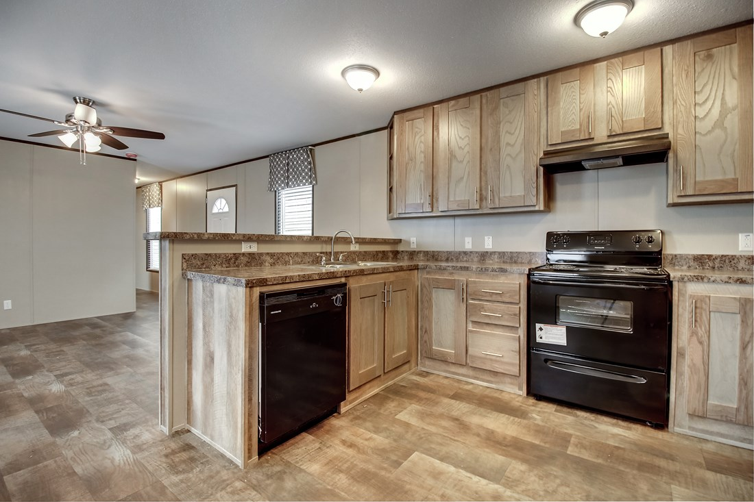 The SMART BUY 16764F Kitchen. This Manufactured Mobile Home features 4 bedrooms and 2 baths.