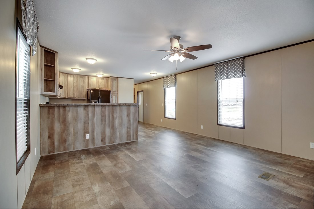 The SMART BUY 16764F Living Room. This Manufactured Mobile Home features 4 bedrooms and 2 baths.