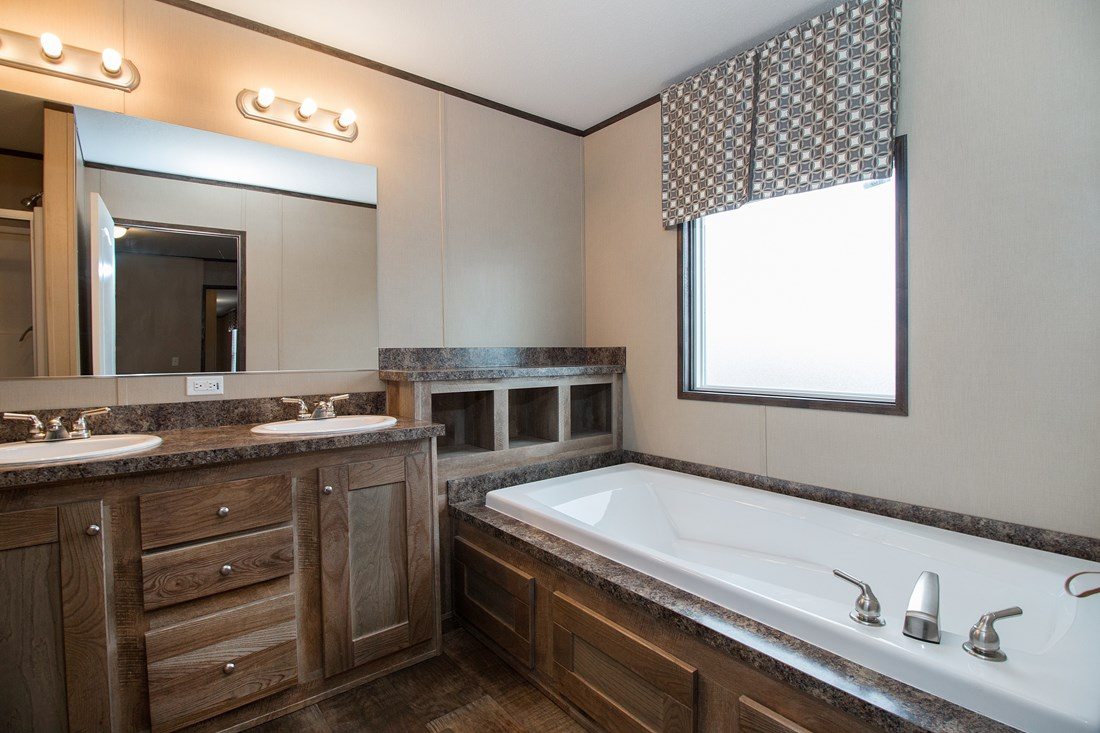 The SMART BUY 16764F Master Bathroom. This Manufactured Mobile Home features 4 bedrooms and 2 baths.