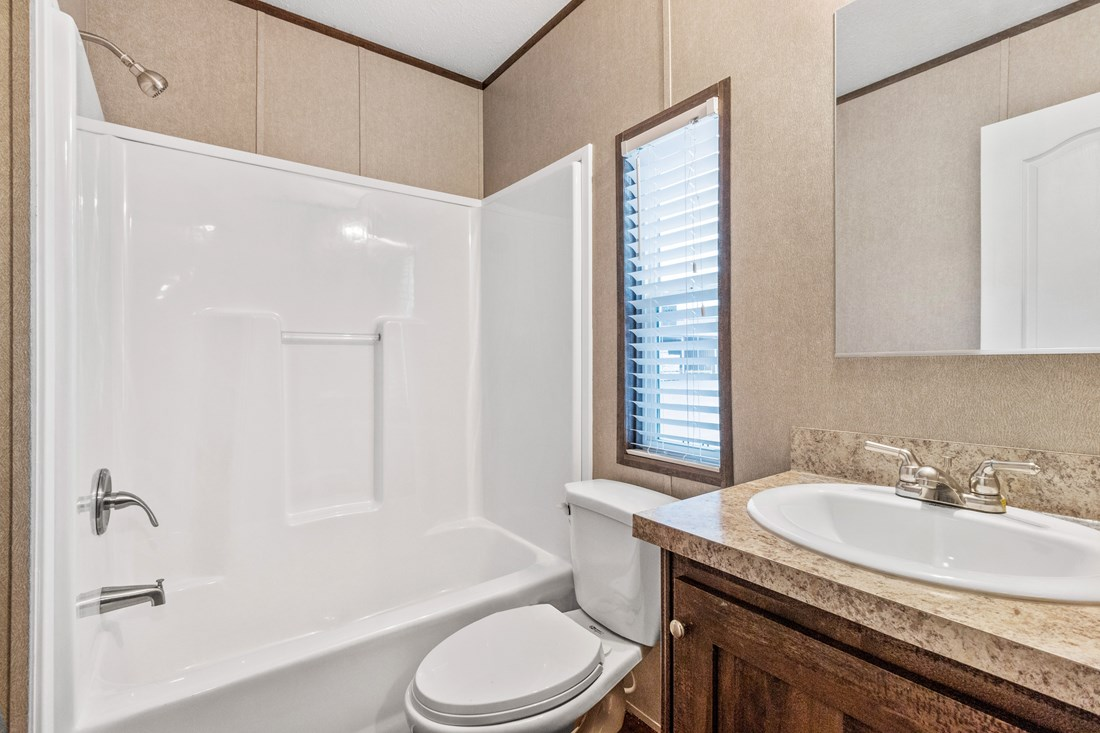 The SMART BUY 16603B Guest Bathroom. This Manufactured Mobile Home features 3 bedrooms and 2 baths.