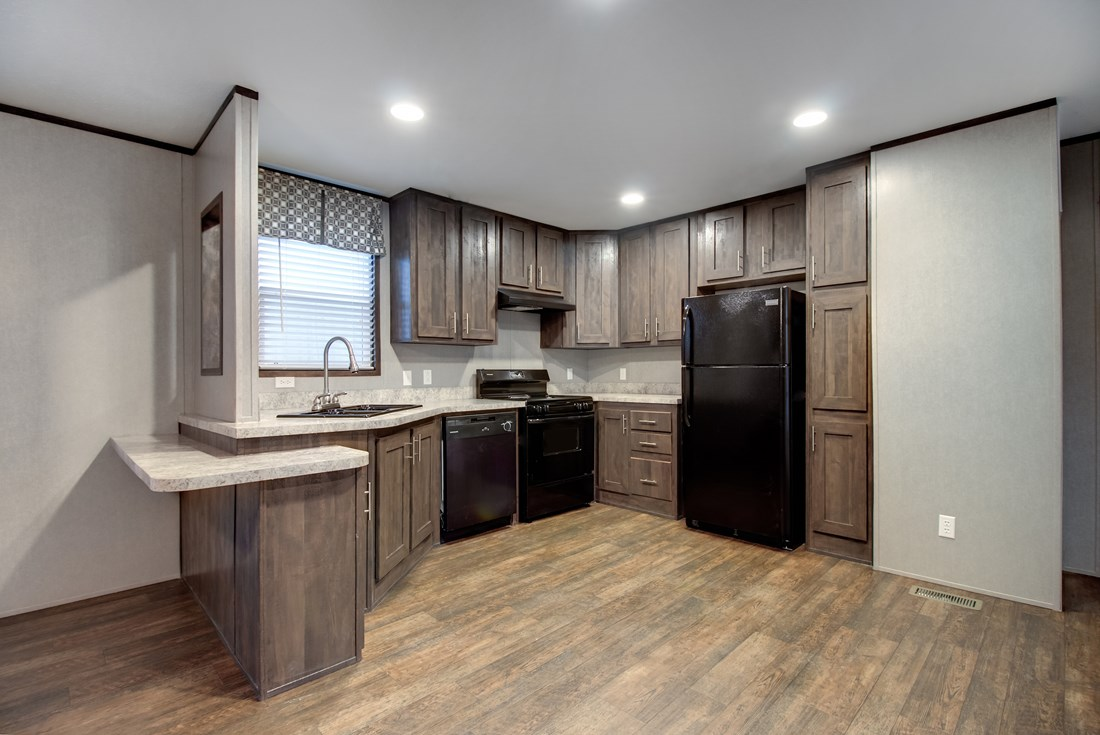 The SMART BUY 16603B Kitchen. This Manufactured Mobile Home features 3 bedrooms and 2 baths.