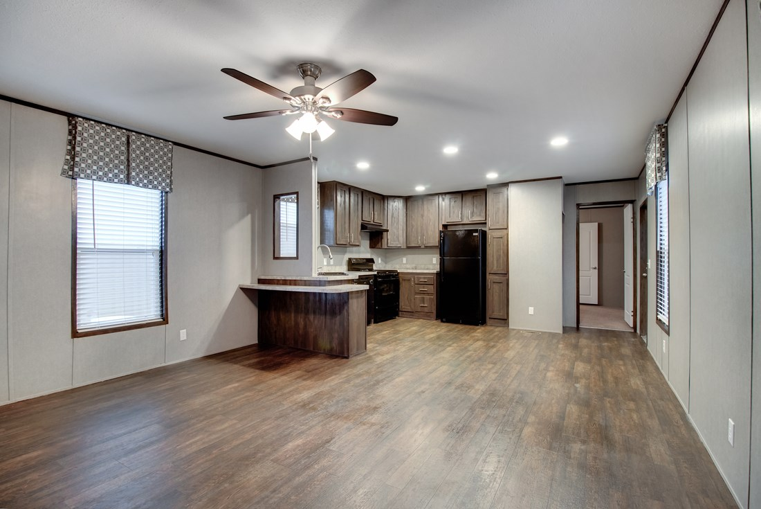 The SMART BUY 16603B Living Room. This Manufactured Mobile Home features 3 bedrooms and 2 baths.