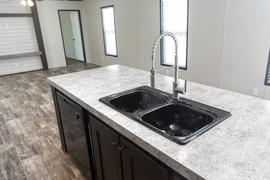 The RESOLUTION 16763B Kitchen. This Manufactured Mobile Home features 3 bedrooms and 2 baths.