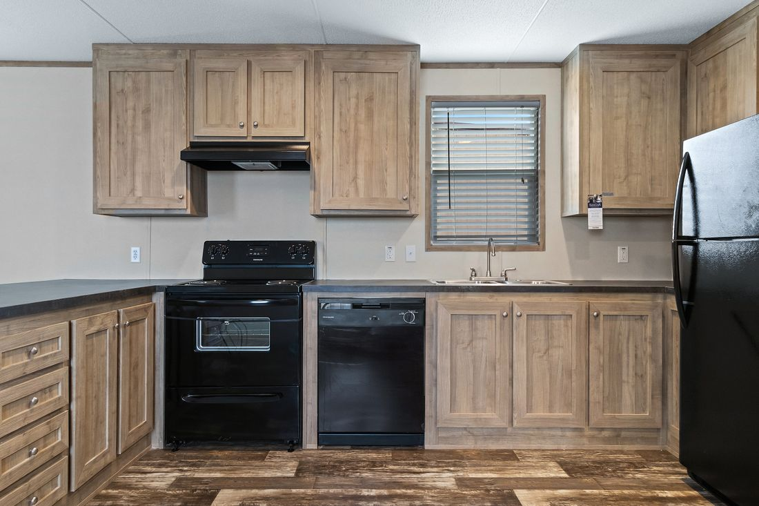 The INDEPENDENT 16763I Kitchen. This Manufactured Mobile Home features 3 bedrooms and 2 baths.