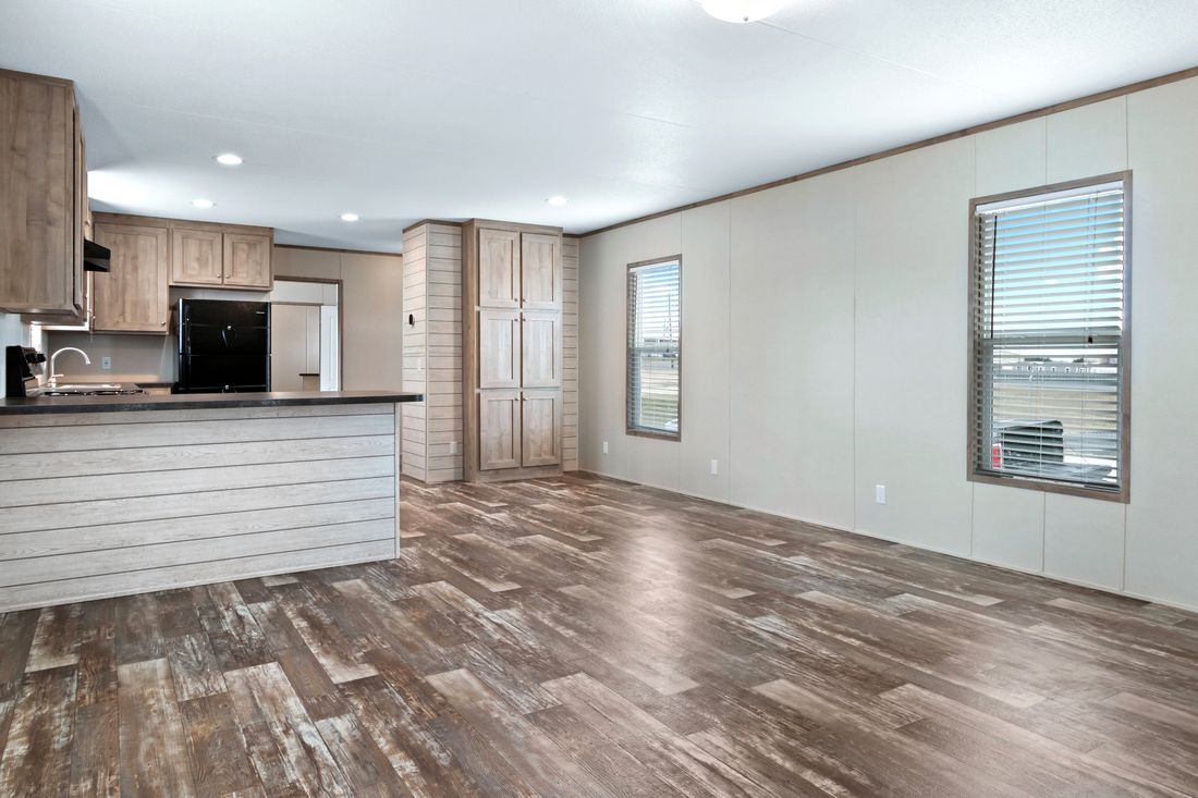 The INDEPENDENT 16763I Living Room. This Manufactured Mobile Home features 3 bedrooms and 2 baths.