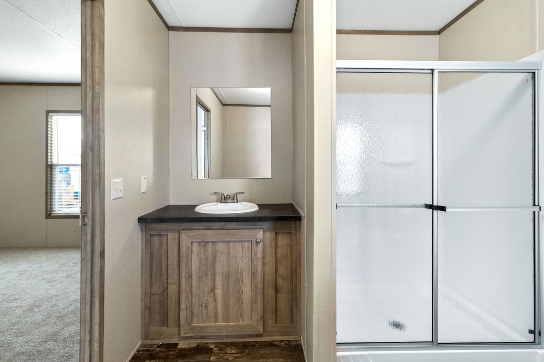 The INDEPENDENT 16763I Master Bathroom. This Manufactured Mobile Home features 3 bedrooms and 2 baths.
