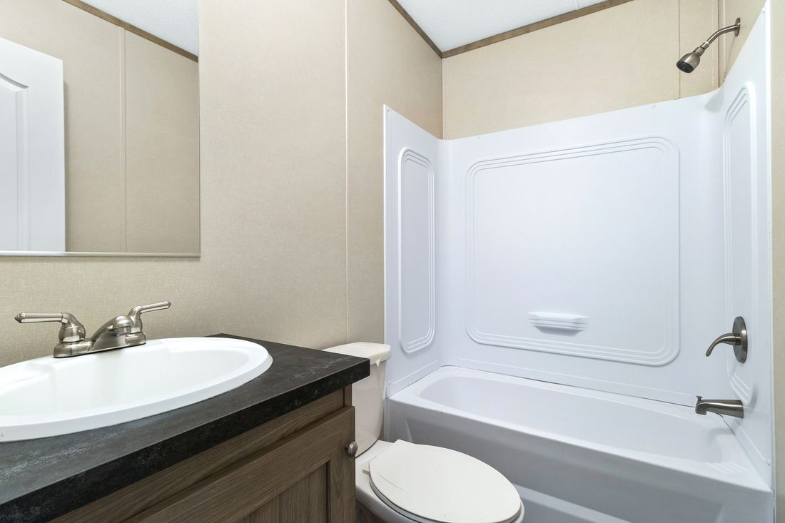 The INDEPENDENT 16763I Guest Bathroom. This Manufactured Mobile Home features 3 bedrooms and 2 baths.