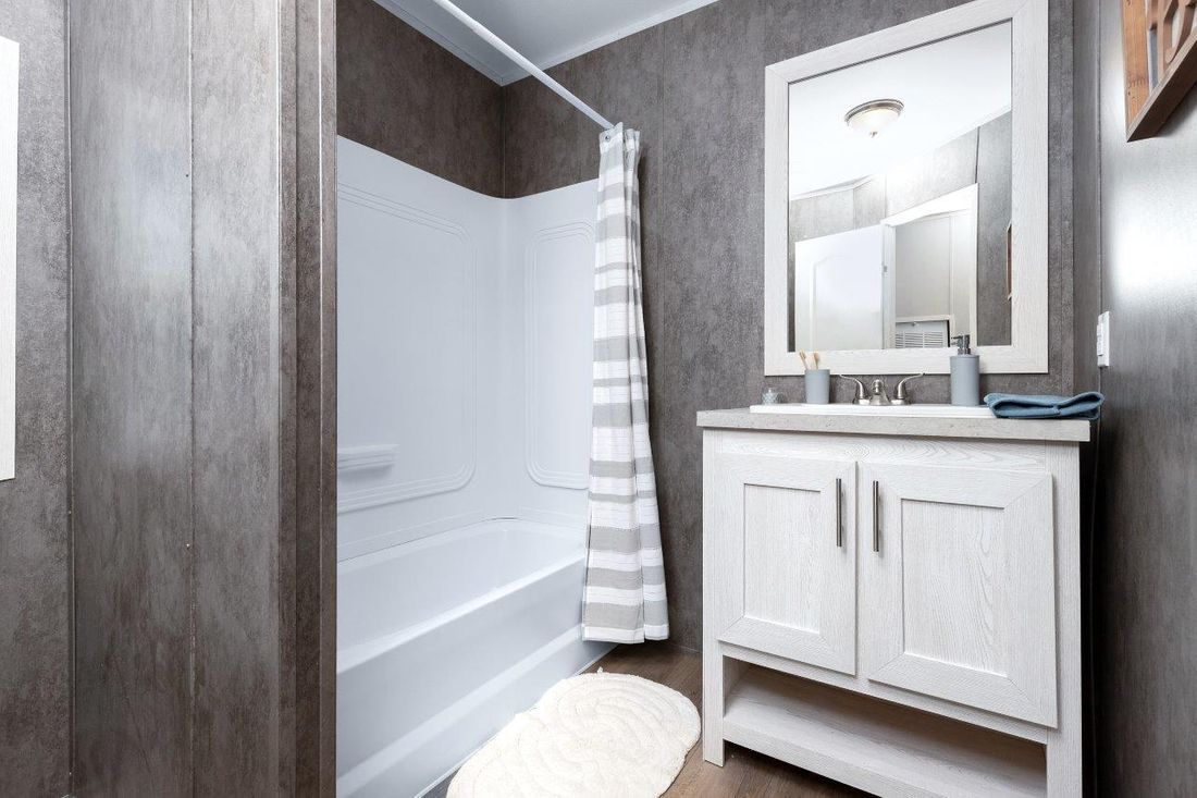 The INSPIRATION 16662A Guest Bathroom. This Manufactured Mobile Home features 2 bedrooms and 2 baths.