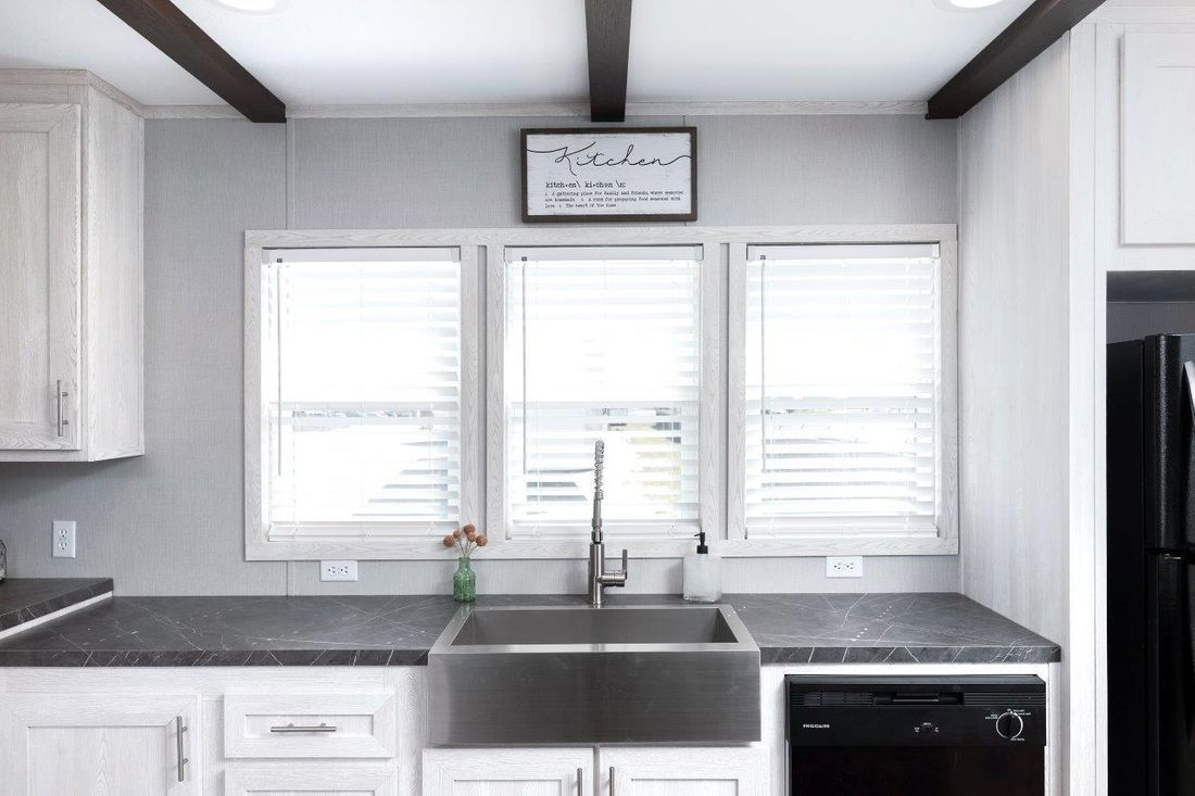 The INSPIRATION 16662A Kitchen. This Manufactured Mobile Home features 2 bedrooms and 2 baths.