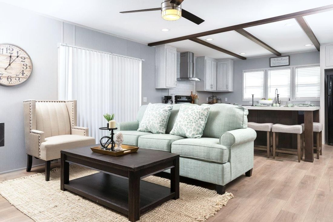 The INSPIRATION 16662A Living Room. This Manufactured Mobile Home features 2 bedrooms and 2 baths.