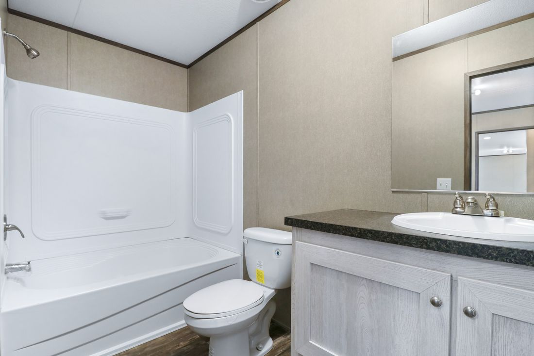 The INDEPENDENT 16562B Master Bathroom. This Manufactured Mobile Home features 2 bedrooms and 2 baths.