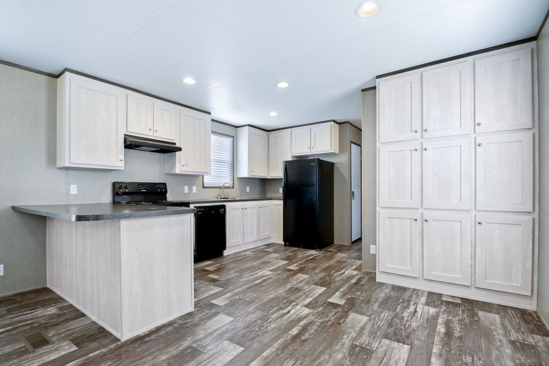 The INDEPENDENT 16562B Kitchen. This Manufactured Mobile Home features 2 bedrooms and 2 baths.