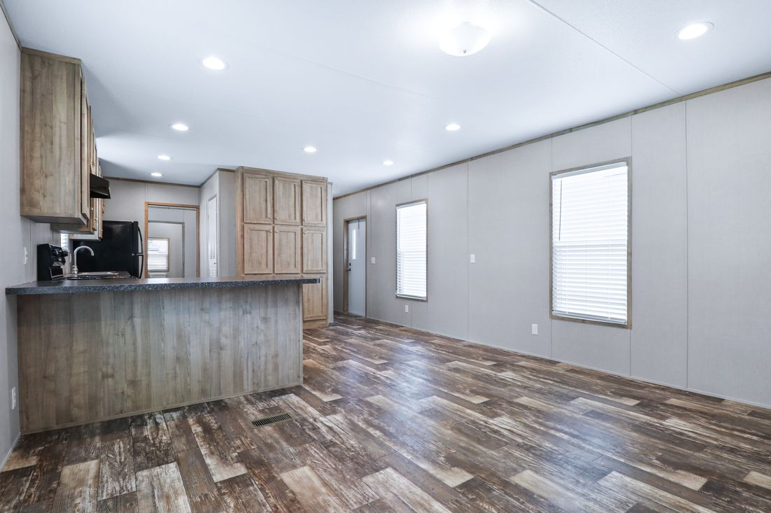 The INDEPENDENT 16663C Living Room. This Manufactured Mobile Home features 3 bedrooms and 2 baths.
