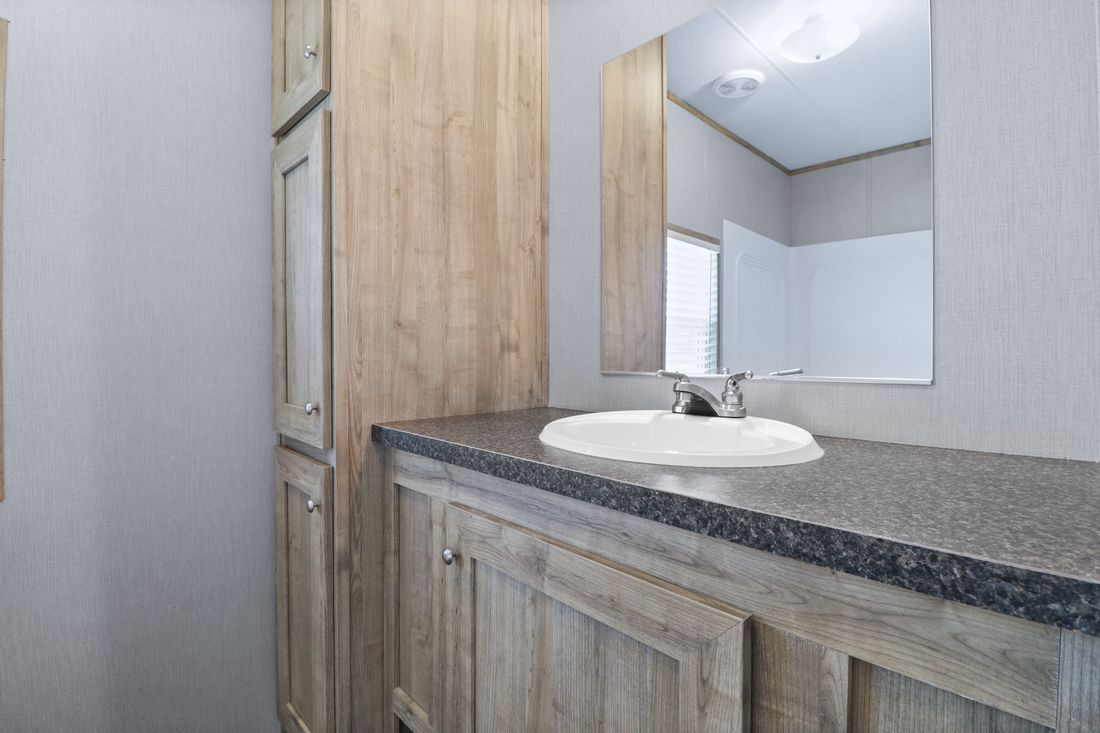 The INDEPENDENT 16663C Master Bathroom. This Manufactured Mobile Home features 3 bedrooms and 2 baths.
