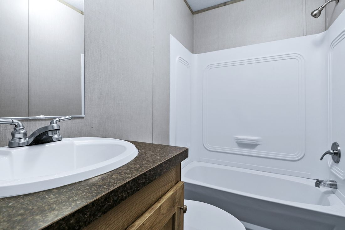 The INDEPENDENT 16663C Guest Bathroom. This Manufactured Mobile Home features 3 bedrooms and 2 baths.