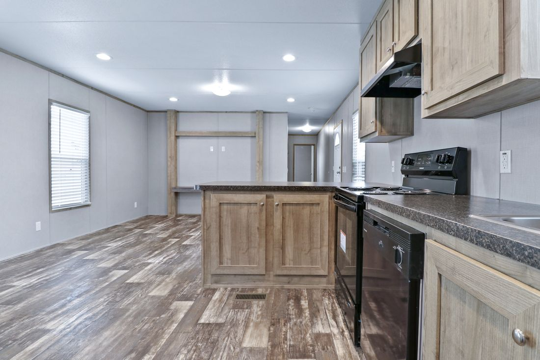 The INDEPENDENT 16663C Kitchen. This Manufactured Mobile Home features 3 bedrooms and 2 baths.