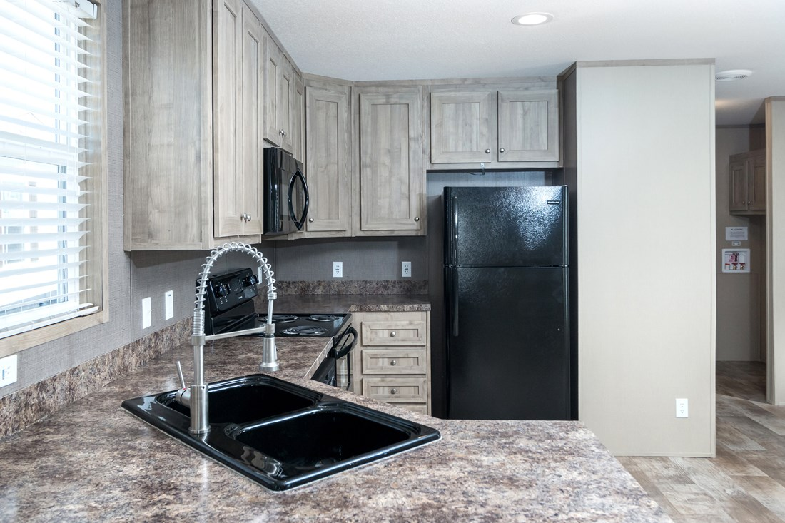 The SMART BUY 16522A Kitchen. This Manufactured Mobile Home features 2 bedrooms and 1 bath.