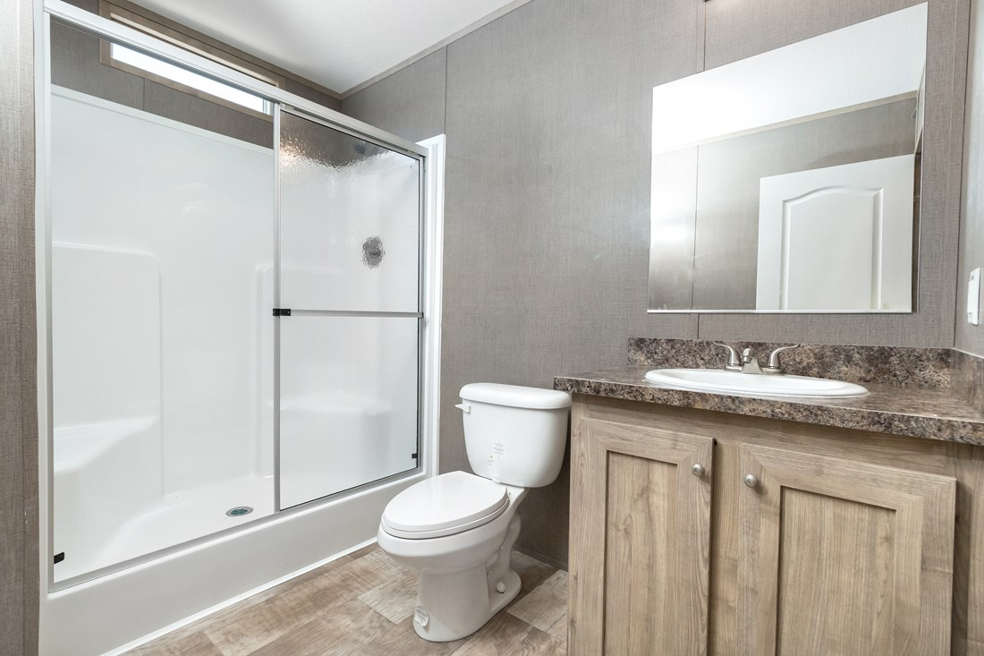 The SMART BUY 16522A Master Bathroom. This Manufactured Mobile Home features 2 bedrooms and 1 bath.